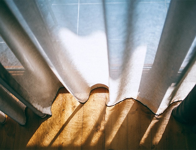 Curtain shown only reducing a small amount of the suns harmful UV rays, General Solar Window Films can eliminate these effects dramatically.