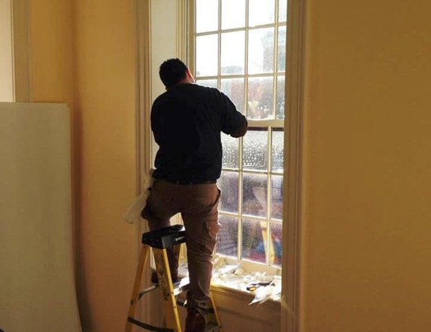 Technician installing professional window film