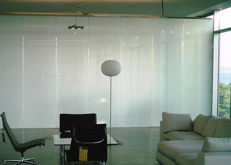 Specialty Film and Cover displayed in a room enhancing the privacy with the addition of Casper Cloaking Technology obscuring digital screens.