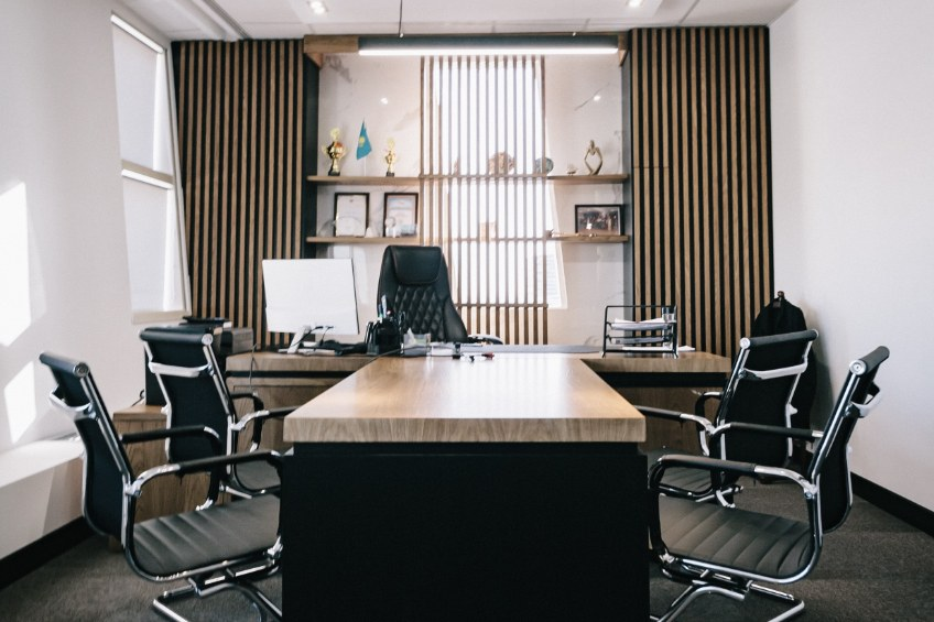 Office space with modern design including wooden counters and paneled walls.